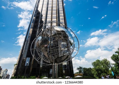 New York City, USA - July 28, 2018: Trump International Hotel and Tower and the silver globe of the Earth with people around in Manhattan in New York City, USA