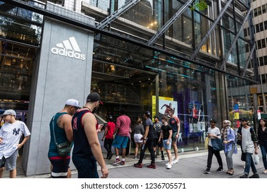New York City, USA - July 28, 2018: Adidas, sports goods store, in Fifth Avenue (5th Avenue) with people around in Manhattan in New York City, USA