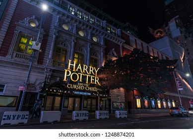 New York City, USA - July 30, 2018: Lyric Theatre where they do the play Harry Potter and the Cursed Child next to Times Square at night with people around in Manhattan in New York City, USA