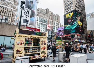 New York City, USA - July 25, 2018: Food trucks in front of the Madison Square Garden with people around in Manhattan in New York City, USA