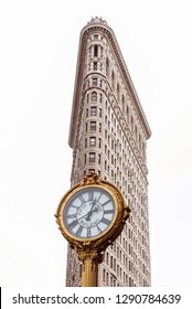 New York City, USA - July 25, 2018: Facade of Flatiron Building isolated on white background with a golden clock in 5th Avenue in Manhattan in New York City, USA