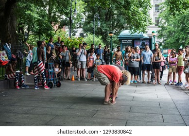 New York City, USA - July 26, 2018: Performance of a group of acrobats and dancers on the street with the participation of the people in Manhattan in New York City, USA
