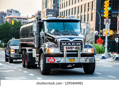 New York City, New York, USA - July 3, 2018; Mack truck driven by truck driver on the streets of NYC during daytime on July 3, 2018 in New York CIty