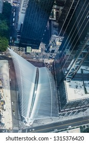 New York City, USA - July 27, 2018: Aerial view of the World Trade Center station (PATH), a transit hub in Manhattan called the Oculus, designed by Calatrava, next to skyscrapers in New York, USA