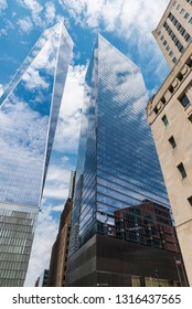 New York City, USA - July 27, 2018: Facade of the One World Trade Center next to other skyscrapers in Lower Manhattan, New York City, USA