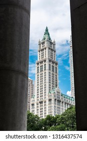 New York City, USA - July 27, 2018: View of the facade of the Woolworth Building between two columns in Manhattan in New York City, USA