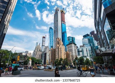 New York City, USA - July 28, 2018: Columbus Circle with traffic, people and Central Park Tower, also known as the Nordstrom Tower, in construction in Manhattan, New York City, USA