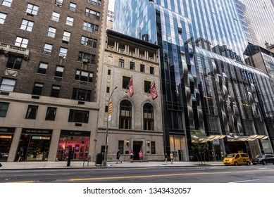 New York City, USA - July 28, 2018: Facade of the Park Hyatt hotel and IESE Business School with people around in Manhattan in New York City, USA