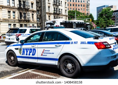New York City, USA - July 31, 2018: Police car parked on street with its logo of NYPD in Harlem, Manhattan, New York City, USA