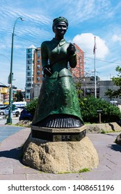 New York City, USA - July 31, 2018: Statue of Harriet Tubman, activist in the struggle for women's suffrage and abolitionist, in the Harlem neighborhood in Manhattan, New York City, USA