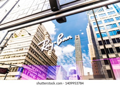 New York City, USA - July 31, 2018: Display of Ray Ban luxury shop with reflections of skyscrapers in Bloomingdale's department store, Manhattan, New York City, USA
