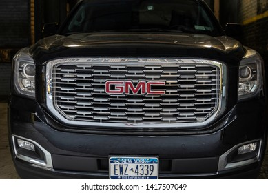 New York City, USA - July 31, 2018: Front of a black GMC Yukon parked on a parking lot in Manhattan, New York City, USA