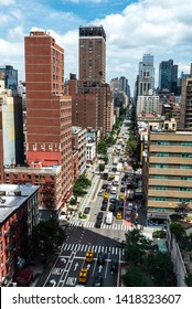 New York City, USA - July 31, 2018: Elevated view of a street with its skyscrapers, traffic and people around in Manhattan, New York City, USA