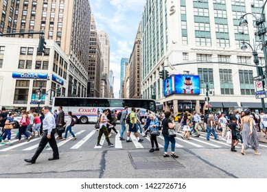 New York City, USA - July 31, 2018: People going through a pedestrian crossing on 7th Avenue in Manhattan, New York City, USA