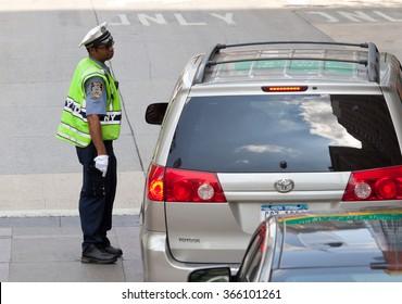 NEW YORK CITY , USA - JULY 07, 2015: Traffic policewoman in city traffic of Manhattan.