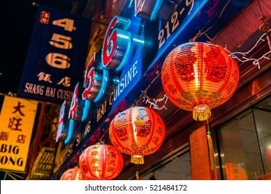 New York City, New York, USA - July 31, 2016: Chinatown at night with paper lanterns and neon signs.