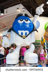 New York City, Usa - July 08, 2015: The M&M world store in Times square. M&M's strikes a pose a la John Travolta's character in the movie Saturday Night Fever.