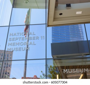 New York City, Usa - July 11, 2015: Entrance of the National September 11 Memorial & Museum. In the glass there is the reflection of the US flag.