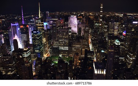 New York City, USA - July 3, 2017: The skyline of midtown New York City and Times Square at night.