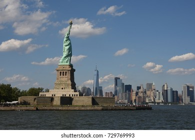 New York City, USA - July 02, 2017: The Statue of Liberty and Manhattan Skyline, Tourist visiting Statue of Liberty and enjoying view of Skyline.