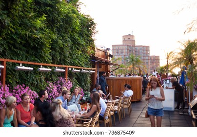 New York City USA - July 13 2015: Tourists and New Yorkers doing an aperitif on the 230 Fifth rooftop. It is the first Rooftop Bar in New York.