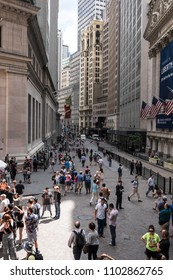 NEW YORK CITY, USA - JUNE 06 2016 - People walking, photograping and calling in Wall Street, New York