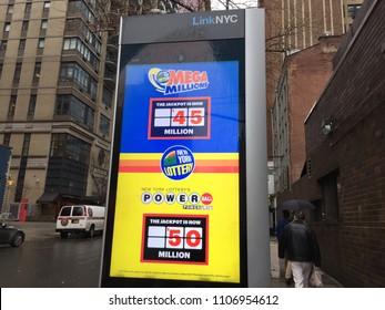 NEW YORK CITY, USA: JUNE 2, 2018: LinkNYC free hotspot Wifi box advertising new york lottery powerball megamillions in midtown Manhattan.
