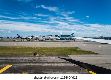 New York City, USA - June 20, 2018: Aircrafts in runway of JFK Airport against blue sky