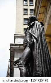 New York City, USA - June 20, 2018: Low angle view view of George Washington statue in Federal Hall in Wall Street
