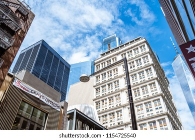New York City, USA - June 20, 2018: Low angle view of  skyscrapers against blue sky in Financial District of New York