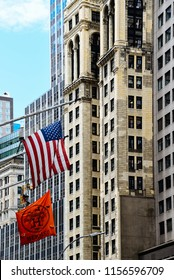 New York City, USA - June 20, 2018: Low angle view of american flag against skyscrapers in Broad Street near NYSE