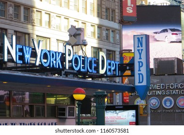 New York City / USA - June 2015: New York Police Department on Times Square.