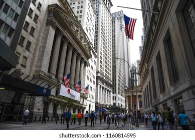 New York City, USA - June 20, 2018: Low angle view of  New Stock Stock Exchange building and American flag from Broad Street