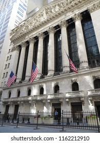 New York City / USA - June 2015: Wall Street New York Stock Exchange Entrance. American Flags.