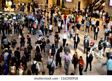 New York City, USA - June 21, 2018: Crowd of people are waiting for the announcement of the departure of trains in main hall of Grand Central Station