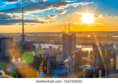 New York City, USA- June 6, 2018: Sunset over New York city skyline. The city is one of the most visited tourist attraction in the country.