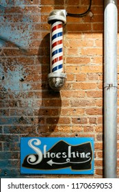 New York City, USA - June 22, 2018: Shoeshine and barbershop signs in Chelsea Market in New York. Chelsea Market is a food hall, shopping mall and office building located in Chelsea