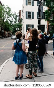 New York City, USA - June 22, 2018: People taking photos at famous corner of Bedford Street with Grove Street in Greenwich Village, featured in Friends the famous American Television sitcom