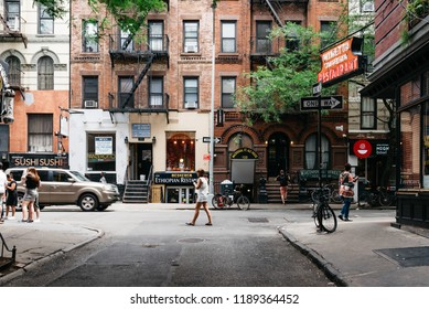 New York City, USA - June 22, 2018: Stores and business in MacDougal Street in Greenwich Village. It has been called the most colorful and magnetic venue for tourists in the Village