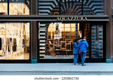New York City, USA - June 20, 2018: Luxury shops in Madison Avenue in Upper East Side of Manhattan. It is one of the richest neighborhood in the city with luxury boutiques.