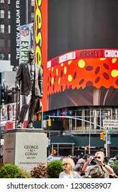 New York City, USA - June 29, 2018: Statue of George M Cohan, located in the middle of the Times Square crowded with tourists.