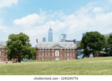 New York City, USA - June 24, 2018: Fort Jay in Governors Island against Downtown cityscape, it is a coastal star fort on Governors Island in New York Harbor