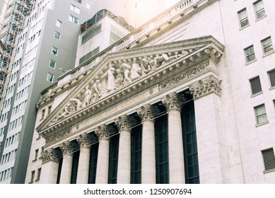 New York City, USA - June 20, 2018: Low angle view of  New Stock Stock Exchange building from Broad Street