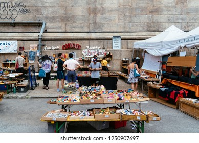 New York City, USA - June 24, 2018: Brooklyn Flea Market in DUMBO. It includes vendors of furniture, vintage clothing, collectibles and antiques, jewelry, art, and craftsand fresh food