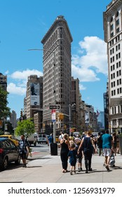New York City, USA - June 20, 2018: Street scene with people at Madison Square against Flatiron Building in Manhattan