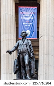 New York City, USA - June 24, 2018: Low angle view of George Washington statue in Federal Hall in Wall Street in Financial District