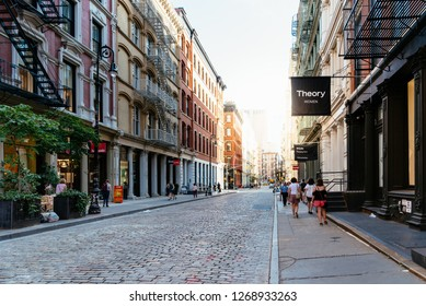 New York City, USA - June 25, 2018: Greene Street with luxury fashion retail stores in Soho Cast Iron historic District in New York City.
