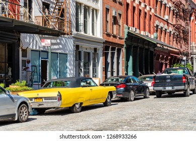 New York City, USA - June 25, 2018: Street scene with classic yellow Cadillac Eldorado convertible car in Tribeca District of Manhattan a sunny day of summer