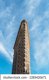 New York City, USA - June 25, 2018: Low angle view of Flatiron Building in Manhattan against blue sky