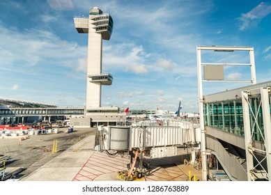 New York City, USA - June 26, 2018: Aircrafts in runway of JFK Airport against blue sky
